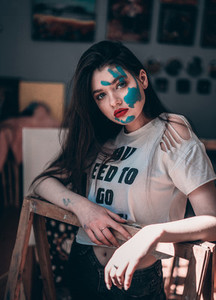 Artist girl with a handprint on face  Concept art with paint