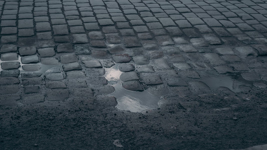 Grey cobblestone with water  Background