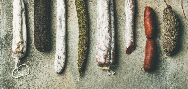 Variety of Spanish or Italian cured meat sausages wide composition