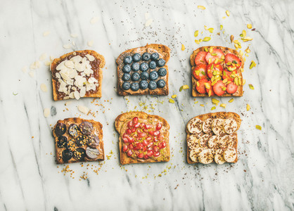 Vegan whole grain toasts with fruit  seeds  nuts  peanut butter