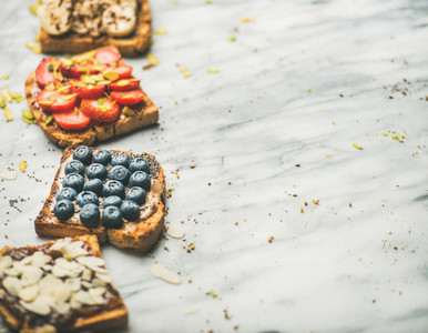 Vegan whole grain toasts with fruit seeds nuts selective focus