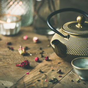 Traditional Asian tea ceremony arrangement over wooden background square crop