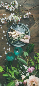 Flat lay of Table setting with spring flowers vertical composition