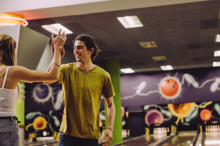 Couple celebrating bowling strike