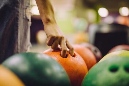 Hand choosing a bowling bowl