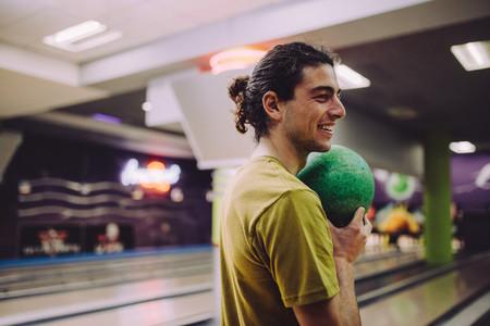 Man playing at bowling alley