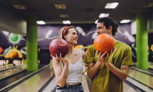 Dating couple enjoying bowling together
