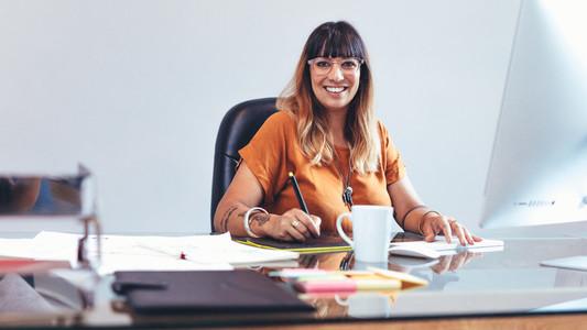 Creative artist at work sitting at her desk