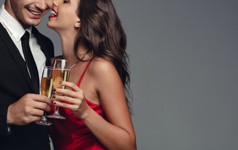 Romantic couple celebrating with champagne