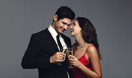 Attractive couple having champagne