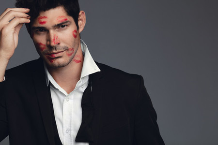Handsome guy covered with kiss marks