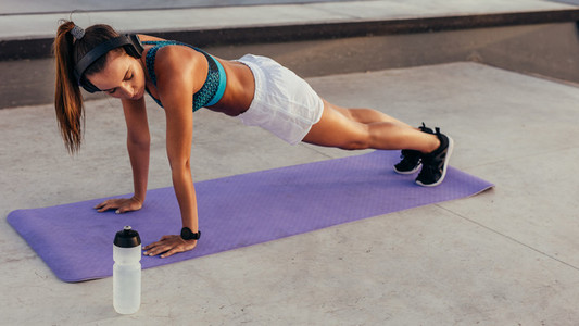 Athlete working out on fitness mat