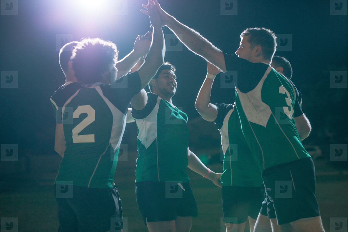 Rugby players celebrating championship win