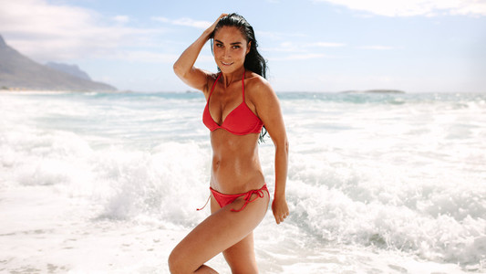 Beautiful woman posing in swimsuit on beach