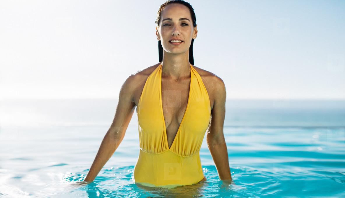 910c8ee4f76 Photos - Beautiful female enjoying in a swimming pool - YouWorkForThem