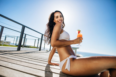 Woman having fun at the poolside