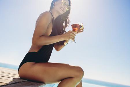 Woman enjoying summer at the poolside