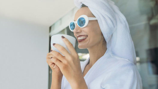 Woman having coffee after shower