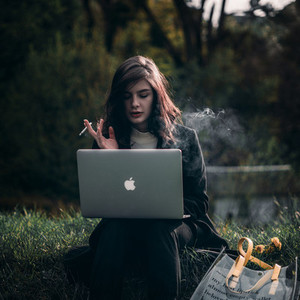 Young hipster girl with a laptop