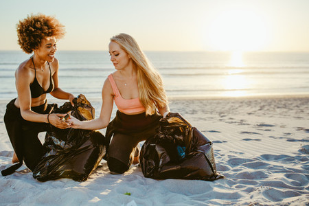 Girls cleaning up garbage from the beach
