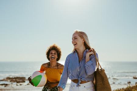 Female friends enjoying on beach vacation