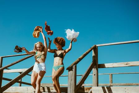 Girls running towards the sea