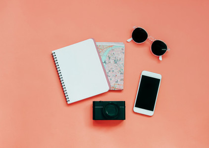 Travel items concept  blank notebook  map  camera  smartphone