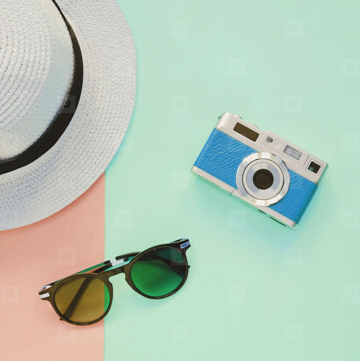 Creative Flat lay fashion style with camera  sunglasses