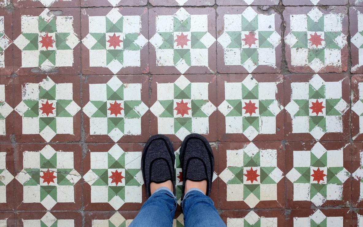 Top view selfie of feet in sneakers shoes