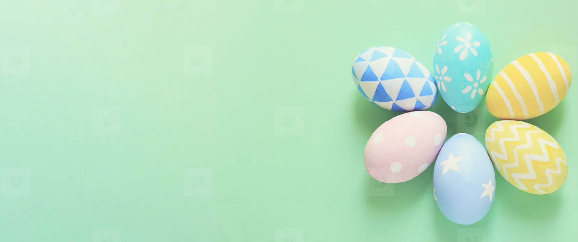 Pastel and colorful easter eggs with copy space