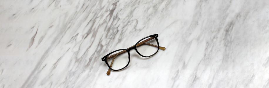 Eyeglasses on black and white marble