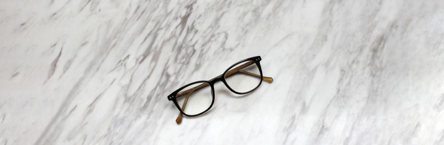 Eyeglasses on black and white marble