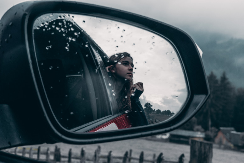 Window view of young girl