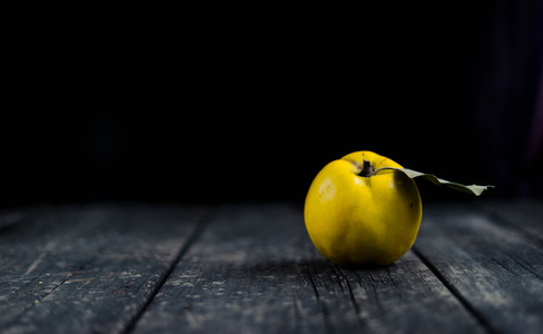 Quince on dark wooden background  Autumn fruits