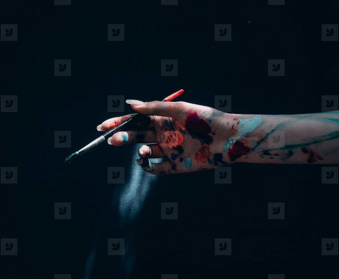 Art brush in dirty hand