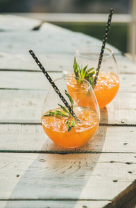 Refreshing cold alcoholic summer citrus cocktail with orange copy space