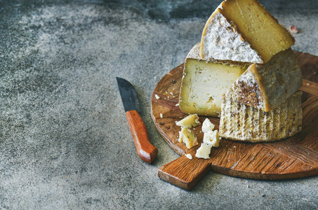 Cheese assortment on wooden board  copy space