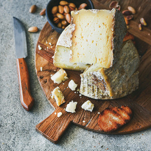 Cheese platter with nuts honey and bread square crop