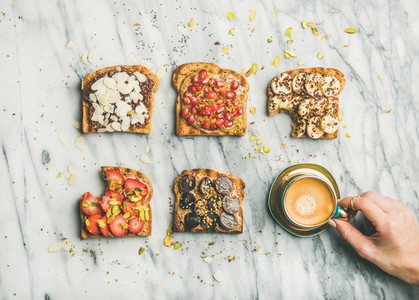 Healthy breakfast with wholegrain toasts  coffee over grey marble background