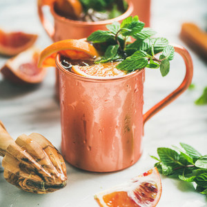 Blood orange Moscow mule alcohol cocktails  square crop