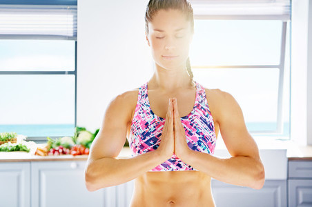 Peaceful content athletic female posing while meditation