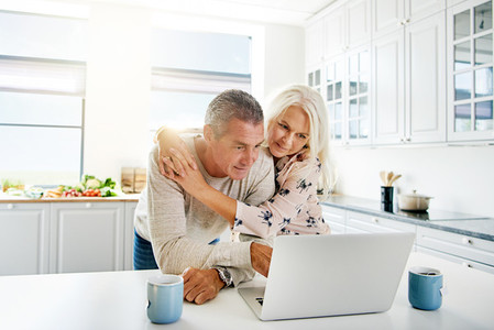 Couple of old people using a laptop