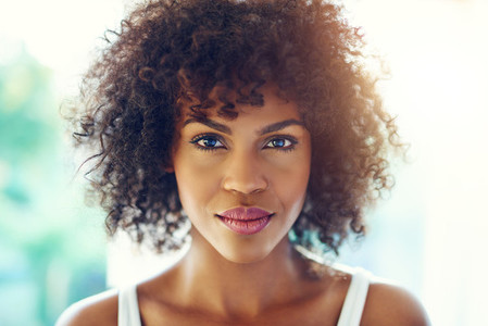 Charming black woman looking at camera