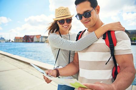 Loving young couple backpacking on honeymoon