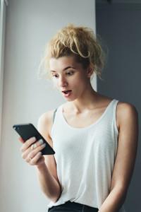 Pretty girl using her smartphone