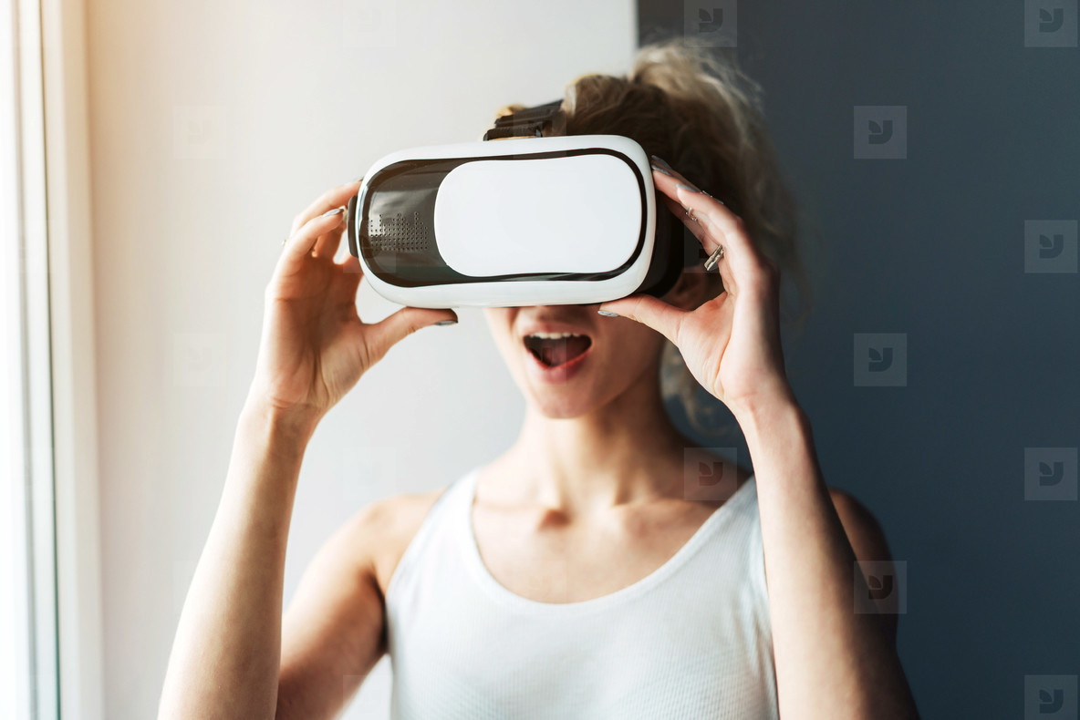 Woman in VR headset looking up