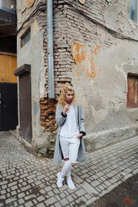 The blonde in the alley