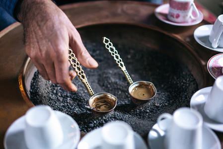 A man make Turkish coffee