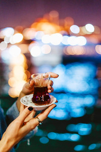 Girl holding tea in her hand