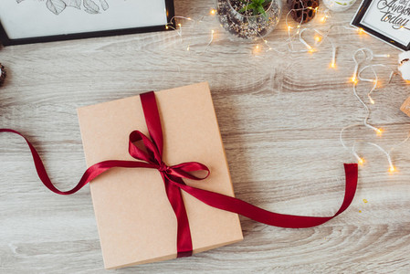 Brown gift box and red ribbon